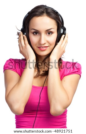 An isolated shot of a beautiful woman listening to music - stock photo