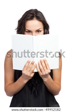 An isolated shot of a beautiful woman reading a book