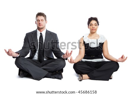 An isolated shot of a black  businesswoman and a caucasian businessman doing meditation - stock photo