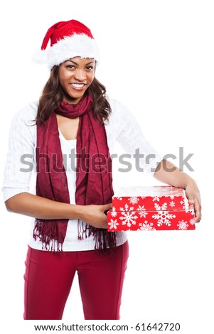 An isolated shot of a black woman celebrating christmas carrying gift boxes - stock photo