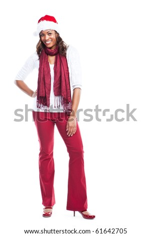 An isolated shot of a black woman celebrating christmas wearing santa hat - stock photo