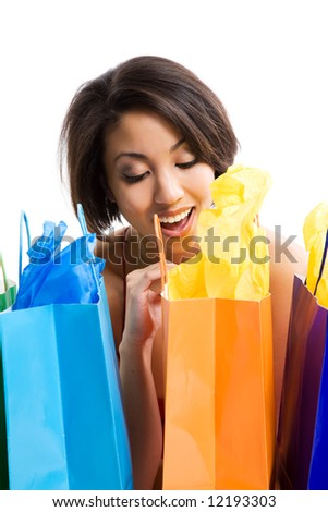 An isolated shot of a black woman looking into shopping bags