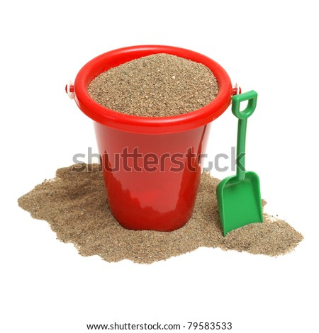 An isolated shot of a bucket of sand for the childrens play time either on vacation, at the beach, or just at home in the sandbox. - stock photo