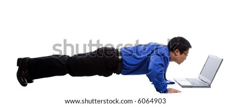 An isolated shot of a businessman doing push up while working on his laptop - stock photo