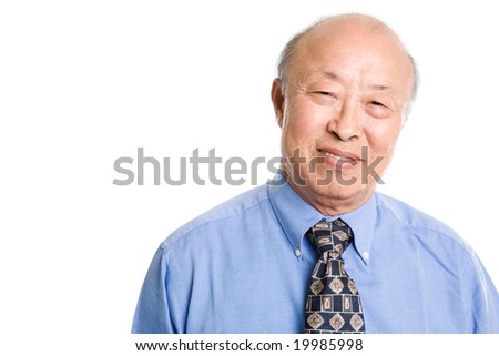 An isolated shot of a smiling senior asian businessman