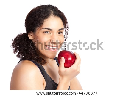 An isolated shot of a woman eating an apple