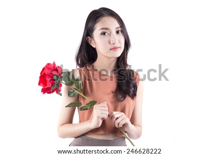 An isolated shot of an asian girl holding a bouquet of red roses celebrating Valentine day - stock photo