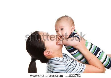 An isolated shot of an asian mother kissing her baby son - stock photo