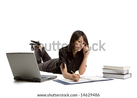 An isolated shot of an asian student girl working on her homework - stock photo