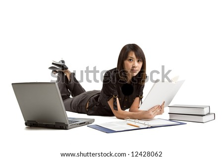 An isolated shot of an asian student studying with books and laptop - stock photo