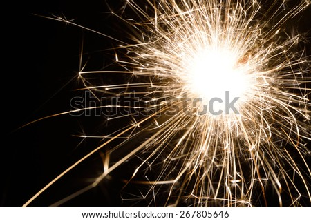 an isolated spark from a sparkler - stock photo