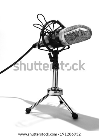 An isolated studio microphone on a white background - stock photo
