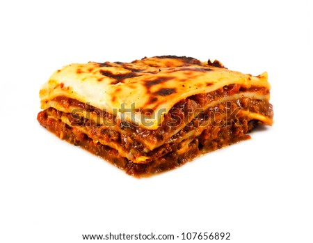 An isolated traditional lasagna made with minced beef bolognaise sauce and three layers of pasta, lasagne in English - stock photo