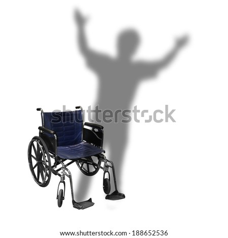 An isolated wheelchair is on a white background with the shadow of a person walking for a handicap or rehabilitation concept. - stock photo