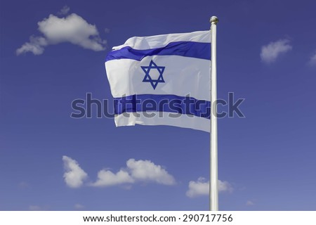 An Israel flag flapping in the wind against the blue sky background with  white clouds. The flag is in white and blue colors with the star of David. The flag is posted on a pole high in the sky. - stock photo