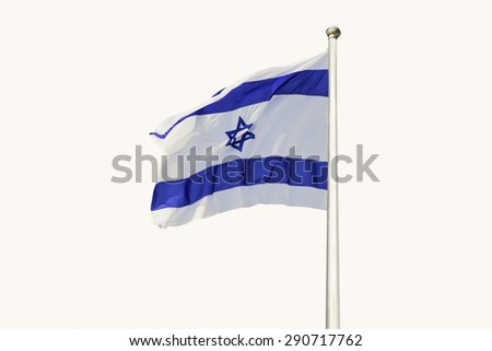 An Israel flag flapping in the wind isolated on white background. The flag is in white and blue colors with the star of David. The flag is posted on a pole high in the sky.