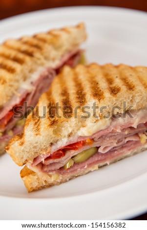 An Italian deli classic ham salami and provolone sandwich on sourdough bread. - stock photo