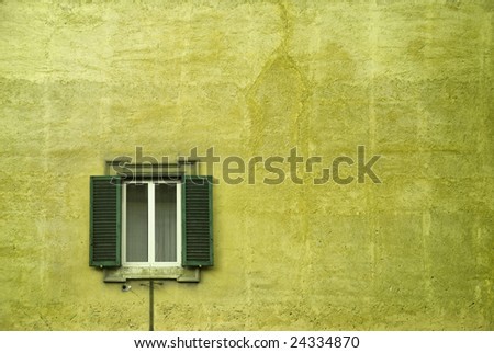 An  Italian window on a large brick wall. - stock photo
