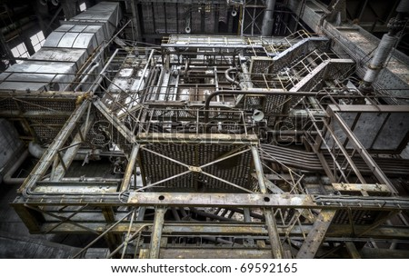 An look upstairs, facing a gigantic staircase at an abandoned factory, creating an abstract image of lines and beautiful toning.