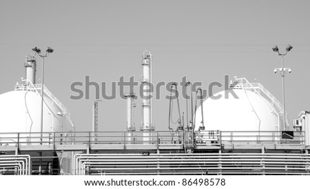 An LPG plant with tanks and stacks - stock photo