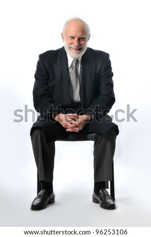 an man sit in a black chair - stock photo