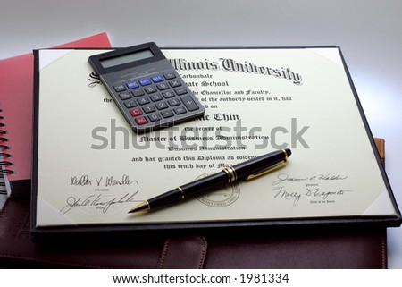 An MBA certificate with a pocket calculator and a pen lying on top; and a dark brown leather executive folder and a red ring-bound notebook underneath. - stock photo