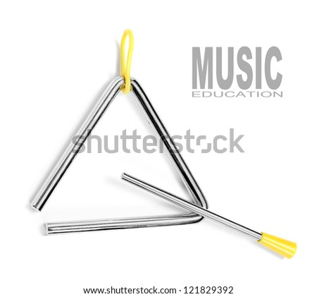 An musical triangle on a white background. Musical education concept. - stock photo