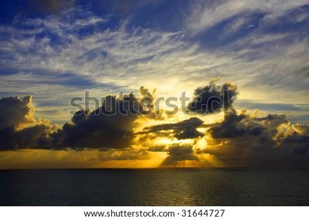 An ocean sunrise. - stock photo