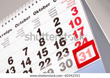 An October calendar showing the 31st prominently - stock photo