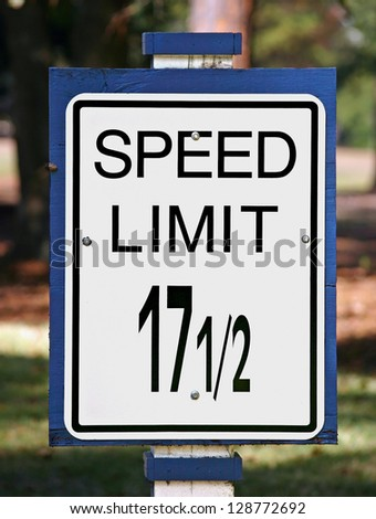 An odd speed limit sign showing the limit as 17 and a half - stock photo