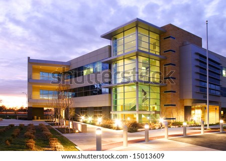 an office building with a empty parking lot building an office
