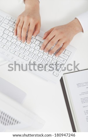 An office lady working on the computer,
