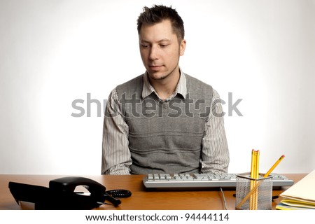 An  office worker waiting for the phone to ring - stock photo