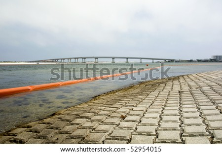 An oil containment boom designed to help keep an oil spill off shore in Orange Beach Alabama. - stock photo