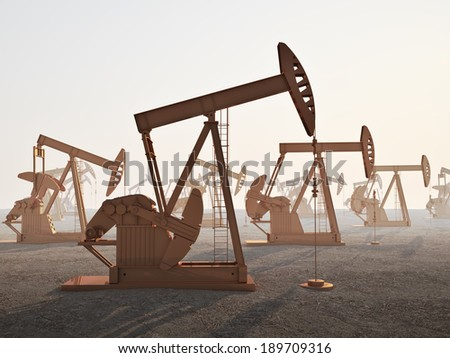 An oil field with jack oil wells - stock photo