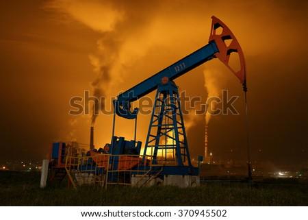 An oil pump jack - stock photo