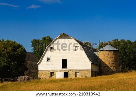 An old abandoned barn in the Wyoming countryside. - stock photo