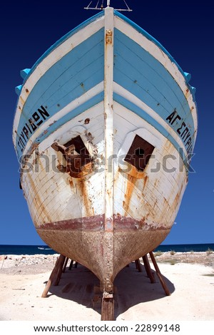 An old abandoned boat propped up on stilts - stock photo