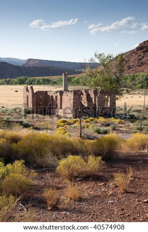 An old abandoned home on the desert landscape of the American Southwest.