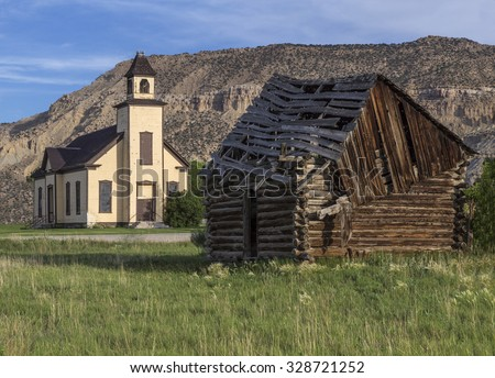 An old abandoned Mormon Church and a cabin built by Mormon settlers in Emery Utah.
