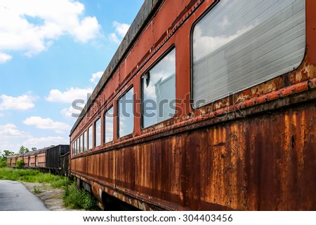 An old abandoned railroad train on tracks