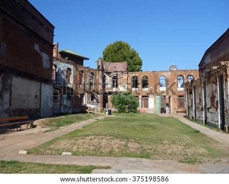 an old abandoned ruined house in a city center - stock photo