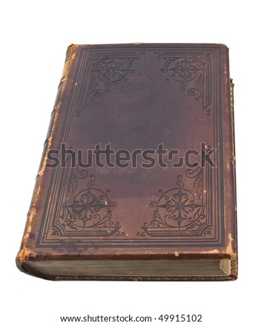 An old, ancient book with a decorative leather cover isolated on a white background - stock photo
