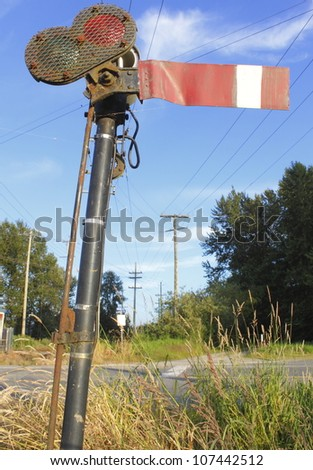 An old, antiquated train signal from the 1930's still in use in Western Canada/Vintage Train Signal/A hand operated train signal still used for train and locomotive operations. - stock photo