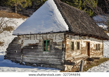 An old barn  in the Moeciu de Jos village in Romania. It is used only in spring, summer and autumn seasons - stock photo