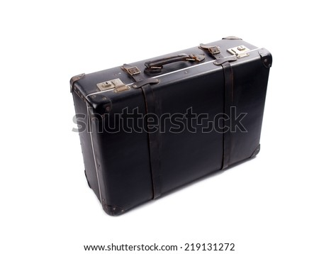 An old black vintage leather suitcase with straps and locks on a white background