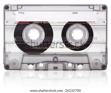 An old blank audio cassette, isolated on white with reflection. - stock photo