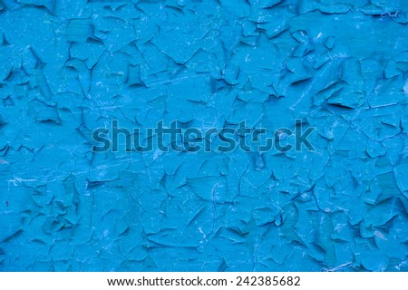 An old blue cracked painted wall as a background - stock photo