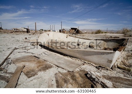 An old boat half burried at the Salton Sea, CA. Bombay Beach area was once a vibrant resort in the 1950s. - stock photo