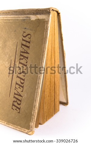 An old book by Shakespeare on white background - stock photo